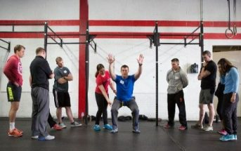 Trainers help beginners in their CrossFit journey